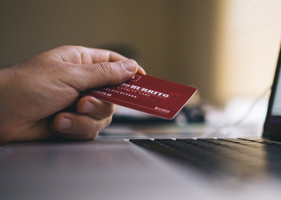 buyer taking credit card out for purchase in online store | Techartus